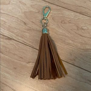 Brown and gold tassel